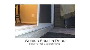 how to put a sliding screen door back into its track