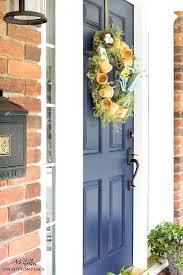 blue front door with garden wreath