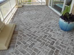 Our normal Savannah Grey Oversize genuine handmade brick used as pavers in  a herringbone pattern at