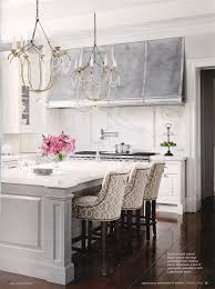 a pair of italian chandeliers in a kitchen designed by interior motives by m n