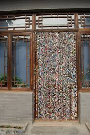diy beaded curtain upcycled paper beads hanging bead curtain would get annoying but a cool idea right
