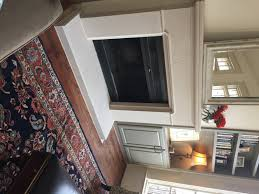 the conrad cast stone mantel that replaced the old wooden mantel