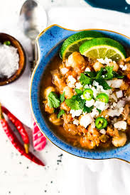 this slow cooker posole or pozole is a traditional mexican stew made with hominy