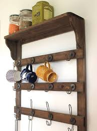 ideas wall shelf hooks: wooden wall shelf with hooks by the forest amp co notonthehighstreetcom