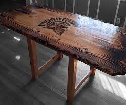 Magnussen winslet oval coffee table with casters in cherry. Burnt Finish Custom Wood Furniture Signature Woodwork