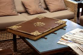 huge old leather book on table by barefootliam stock