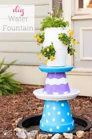 great outdoor water feature idea for the yard love the colors and whimsy of this