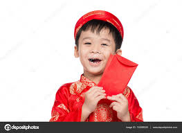 little vietnamese boy holding red envelops for tet the word mean double happiness it is the gift in lunar new year or tet holiday on red isolate
