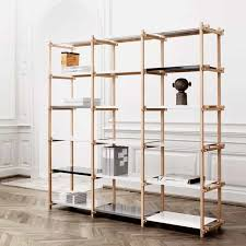 woody shelving system is made of soap treated oak sticks and powder coated steel the here shown is the largest of the woody collection