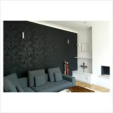 black wall paper feature wall where fireplace is