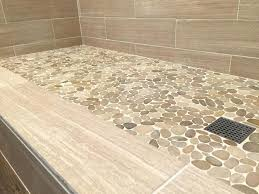 river rock shower floor master bath pale pebble tile shower floor natural neutral shower wall tile