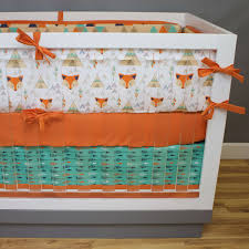 this fox crib bedding collection features tees arrows and triangles how can you go wrong we are loving this orange teal and navy baby boy crib