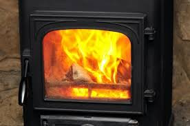 cleaning glass doors on a wood stove