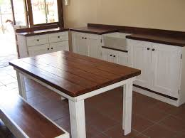 small white kitchen table with bench