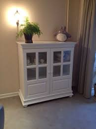 white sideboard with glass doors white sideboard for storage of utensils towels and other things