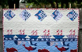 Show Off Saturday... a Sailboat Storytelling Quilt — SewCanShe ... & And looking at this end of the quilt, there are 6 little ships sailing  under a starry sky. We'll be turning the quilt round and round telling a  tale of ... Adamdwight.com