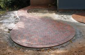 cozy circular patio with pine hall brick pavers like the shape but not the round brick