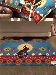 these fun and fanciful rugs with a bright southwest flavor are designed around and with a collection of pillows and other accent elements