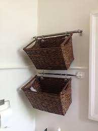 Cut down a curtain rod and hang wicker baskets for cute \u0026 easy ...