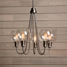 chic and versatile display this 5 light chandelier with mouth blown glass shades or without them for a more industrial themed look