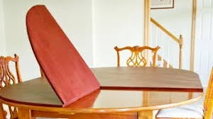 dining table pads. Photo: Table Pad Raised To Show Fabric Underside Dining Pads