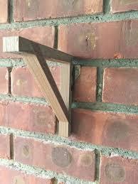 hang a shelf on my brick wall