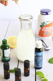ings for homemade mouthwash on a table with a glass bottle