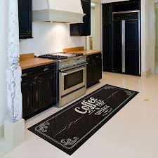 letter patterned black rugs floor runner with wooden kitchen cabinet and small cooktop also white painted kitchen backsplash