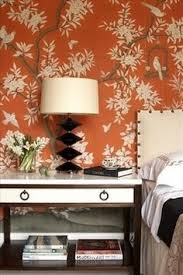 Hand - painted Chinoiserie wallpaper in orange is so dramatic and works  with traditional or modern furnishings.