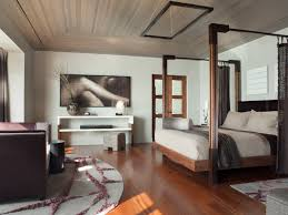 Inspiration for a contemporary medium tone wood floor bedroom remodel in  San Francisco with white walls
