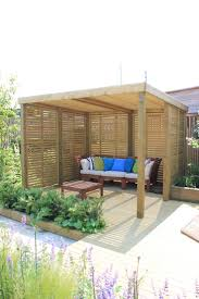 A contemporary garden shelter from Jacksons Fencing. A timber structure -  with a 25 year