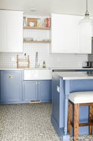 beautiful farmhouse kitchen with blue white cabinets and a large farmhouse kitchen sink