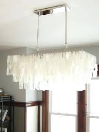 west elm capiz chandelier shell dining room update a decor adventures west elm capiz chandelier