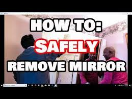 how to safely remove a glued on mirror
