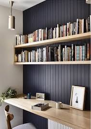 Floating shelf desk Shelves Above Lightcolored Floating Shelves And Matching Floating Desk In Front Of Dark Wall Comfydwellingcom 31 Floating Shelves Ideas For Your Home Comfydwellingcom