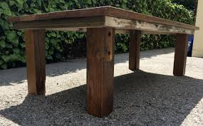appealing square handcrafted brown reclaimed wood coffee table over concrete pavers as gardening patio furniture ideas