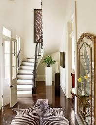 black and white zebra cowhide rug gilded mirror entrance