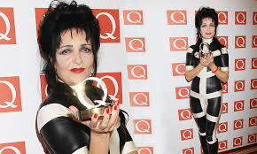 siouxsie sioux 54 slips into a rubber jumpsuit at the q awards daily mail