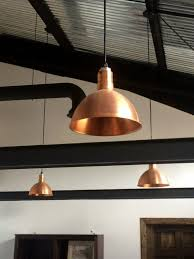 office space area lighting warehousing. copper pendant lighting elevates industrial office space area warehousing