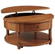 pemberly row round lift top coffee table in oak pr 496844