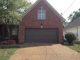dark brown garage doorsPainted the garage door a dark beige brown  Our First House