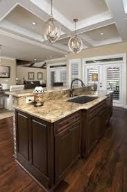 lighting over a kitchen island. interesting over kitchen island lighting over brown mosaic granite top bar and a