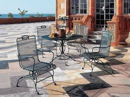 furniture black iron outdor dining set using round table with chair using arm and carved black wrought iron patio