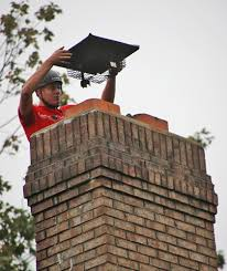 chimney specialists installing chimney top