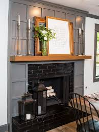 the existing brick fireplace was retained but updated with black interior new trim in dark