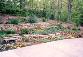 Small Picture Curved stone retaining walls and huge boulders on hill Rustic