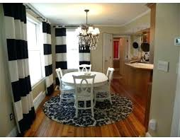 round rug under dining room table love this look 3 rugby championship nz rug under round dining table