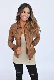 zippered brown leather jacket ripped black jeans and a top