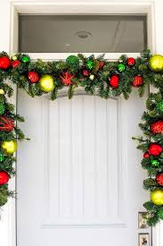 Green Tinsel Wreath With Twinkling Lights 8 Christmas Decoration Hanging Hacks How To Hang Garland