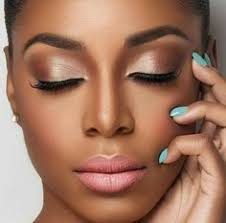 i love this eye shadow the lipstick the blue nail polish everything just seems to match perfectly with her dark skin check out more of my friday